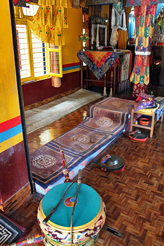 Carpeted platforms were monks sit during puja and daily prayers