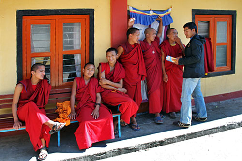 Monks relax at Shree Gaden Dhargay Ling Monastery