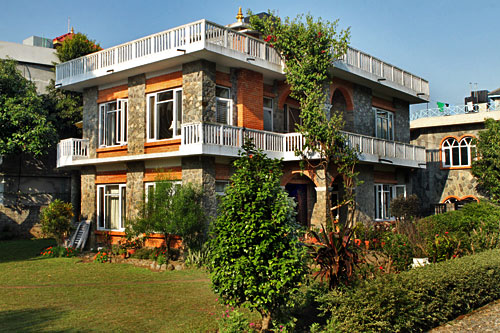 Temple Villa Hotel is surrounded by lovely gardens Pokhara Nepal