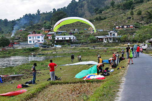 Paragliders take off from top of Sarangkot and land on the shores of Phewa Lake Pokhara Nepal