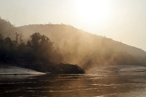 Mists rise from Mekong River at dawn