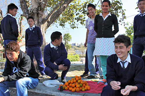 Nepali kids convince me to throw orange peels in field for recycling