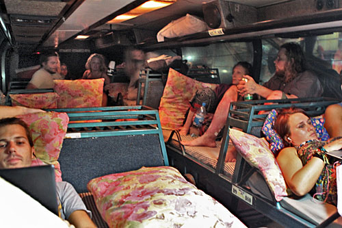 Triple tier of beds inside the overnight Sleeping Bus that travels between Vientiane and Pakse, Laos