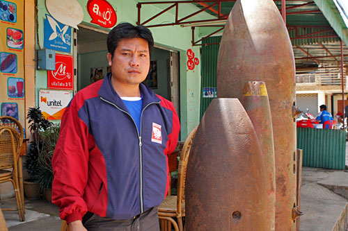 Bounmy Vichack lost left arm when UXO exploded while digging fish pond on his family farm