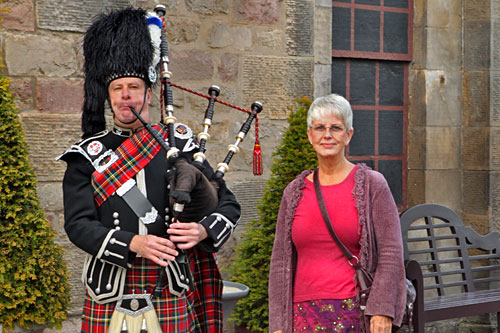 "Me in a skirt, posing next to a Scottish bagpiper at the entrance to ""Taste of Scotland"""