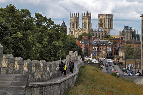 Walking the city walls around medeival York, with York Minster in the background