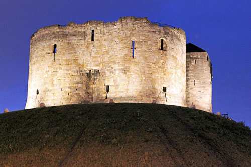 Spotlighted Clifford's Tower at night